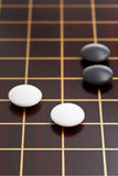 Black and white stones during go game Stock Photo