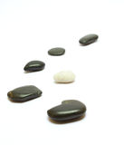 Black and white stones on white Royalty Free Stock Photos