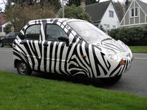 Striped 3-Wheel Car in Portland, Oregon. This is a black & white striped car with 3 wheels in a residential area of Portland, Oregon Stock Photos