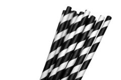 Black and white striped ecologically friendly paper drinking straws on white background. Black and white striped ecologically friendly paper drinking straws royalty free stock photo