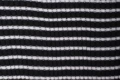 Black and white striped knitted fabric. Close up. Fashionable co stock photography
