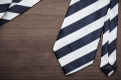 Black and white striped necktie on wooden table Stock Photo