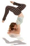 Black white striped pants back bend legs up split Royalty Free Stock Photo