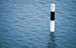 Black and white striped spar buoy royalty free stock images