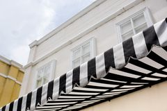 Black and white striped sunblind Stock Image