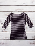Black and white striped top. Casual top with long sleeves. Female garment in outlet shop. Good quality at fair price Stock Images