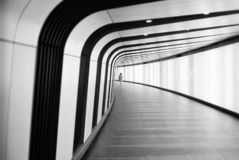 Black and white striped tunnel. Black and white striped long tunnel to the surface stock photography