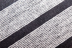Black and white stripes on a rug. Wool rustic rug with  white and black stripes, texture background Stock Photography