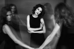 Black and white studio photo of five women in black dresses. Blu Royalty Free Stock Photos