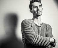Black-white studio portrait of young handsome man in knitted sweater. Close-up photo. Royalty Free Stock Photography