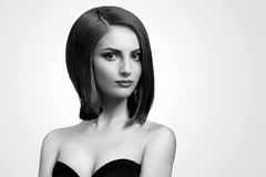 Black and white studio shots of a classy young woman with short. Simple elegance. Monochrome studio portrait of an elegant young short haired woman copyspace Royalty Free Stock Photos