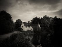 Black and White Stunning Autumn English Country Mill Cottage Hou Stock Images