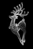 Black and white stylized deer on black background. Christmas card with black and white stylized deer Royalty Free Stock Photo