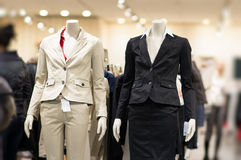 Black and white suits on mannequins in mall. Black and white suits on mannequins in shop Royalty Free Stock Photo