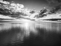 Black and white sunset over water Stock Photography