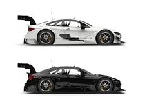 Black and white super sports cars - side view. Isolated on white background Royalty Free Stock Photography