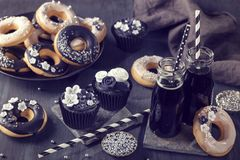 Black and white sweets and charcoal lemonade stock photos