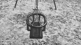 Black and white swing. Playground outdoors day bnw sand catena Royalty Free Stock Image