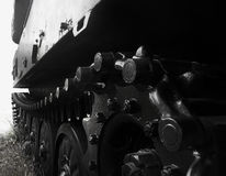 Black and white tank caterpillar wheel side view photo. Royalty Free Stock Images