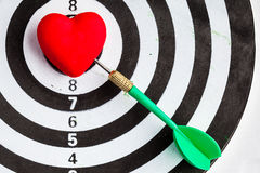 Black white target with dart in heart love symbol as bullseye Stock Photos