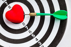 Black white target with dart in heart love symbol as bullseye Royalty Free Stock Photo