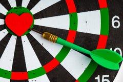 Black white target with dart in heart love symbol as bullseye Stock Photos
