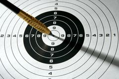 Black and white target with dart and shadows Royalty Free Stock Images