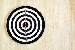 Black and white target dart on wooden background. Top view. Stock Images