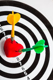 Black white target with two darts in heart love symbol as bullseye Stock Photos