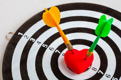 Black white target with two darts in heart love symbol as bullseye Stock Photo