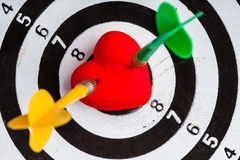 Black white target with two darts in heart love symbol as bullseye Stock Image
