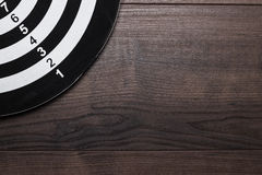 Black and white target on wooden background Royalty Free Stock Photos