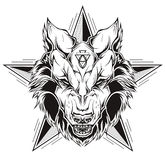 Black and white tattoo of a wolf head with star. Stock Image