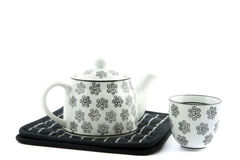Black and white teapot and teacup royalty free stock images