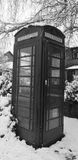 Black and White Telephone box in the snow Stock Photography