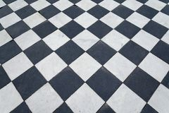 Black and white tiles. Chess floor. Black and white tiles. Chess floor as background stock images