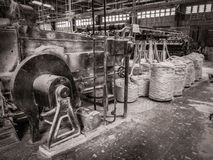 Black and White Tinsel Twine Factory Port-Au-Prince Haiti. This is a wonderful black and white image of a Tinsel Twine factory on Boulevard Toussaint Louverture Stock Photo