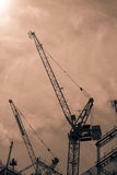 Black and white toned cranes Royalty Free Stock Images