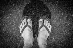 Black and white of Top view feet in sandals selfie shot of asian Royalty Free Stock Photos