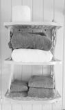 Black and White Towels on Shelves. In Bathroom royalty free stock image