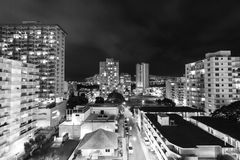 Black and White Town. The streets of Honolulu shining bright in contrast to the dark sky. This shot sucks you into the city and for a second you forget you are Royalty Free Stock Photography