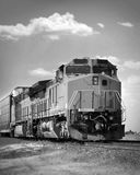 Black and white train. A cargo train on the tracks royalty free stock photography