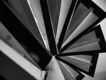 Black and white treacherous spiral staircase. Symmetry Royalty Free Stock Image