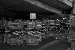 Black and White of Trollies in Flood. Black and White of shopping trollies in a pool of water Stock Image