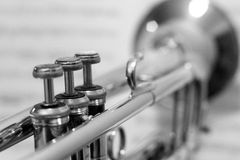 Black and White Trumpet with out of focus sheet music Stock Image