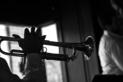 Black and white trumpet player royalty free stock images