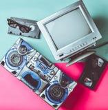 Black white tube TV, tape recorder, video cassette, 3d glasses on mint pink background. Retro media technologies. Entertainment. Black white tube TV, tape stock photo