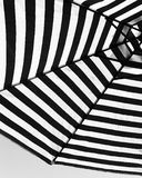 Black and White Umbrella. Shot from underneath a striped garden umbrella in black and white Royalty Free Stock Photo