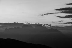 Black and white Unesco Dolomites silhouette with clouds. From Monte Pizzoc summit, Veneto, Italy Royalty Free Stock Images