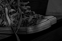 Black and white used shoes. Monochromatic photography Royalty Free Stock Photography